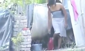 Indian hot village doll laving outside,