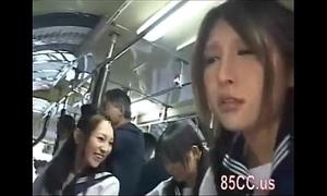 Oriental schoolgirls groped relative to a bus