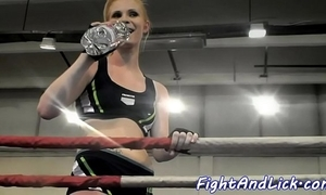 Athletic lesbians wrestling in prizefighting ring